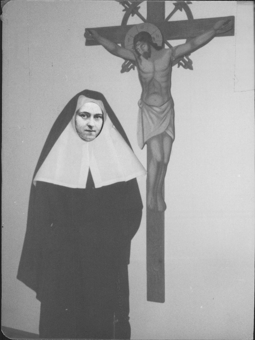 Nun next to crucifix